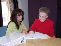 A study coordinator visits with a patient