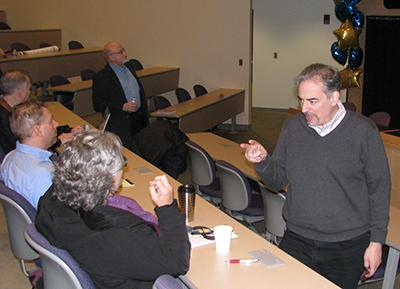 Ari Melnik speaks with Paula Vertino before lecture
