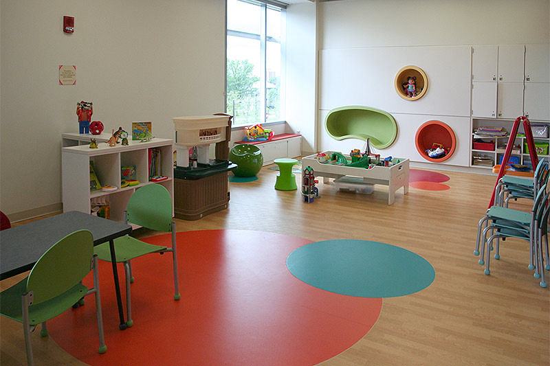 Play area featuring toys and chairs