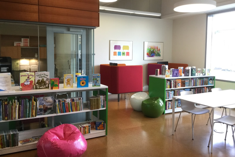 Play area showcasing books and other toys