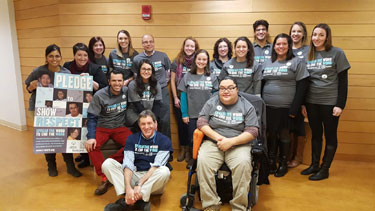 Photo of LEND Fellows Wearing Spread the Word to End the Word Shirts