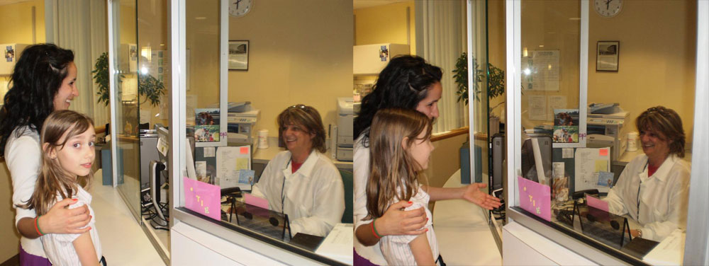 Mother and patient checking in at the front desk