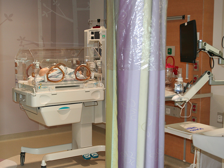 NICU room with medical training doll as patient