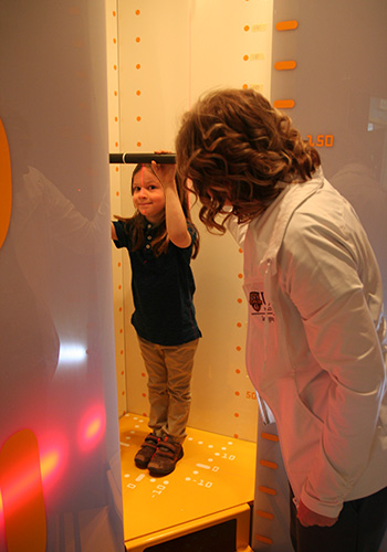 Child standing in EOS X-ray machine