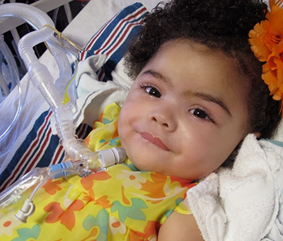Girl smiling with tracheostomy