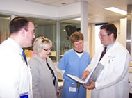 Dr. Greenlaw consults with colleagues