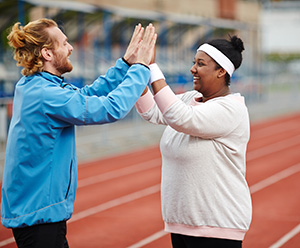 Two people on running track