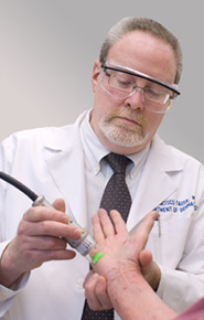 Dr. Tausk administers treatment using an excimer laser