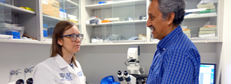 Fellow Kalyna Jakibchuk confers with Dr. Javier Rangel-Moreno in the lab
