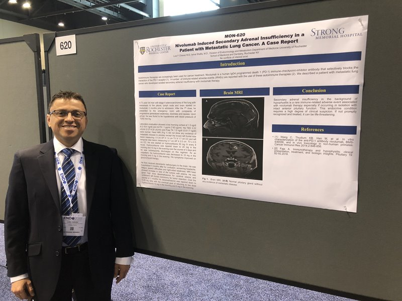 Dr Chavez with Poster