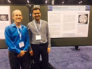 Dr. Hammes and Dr. Azim with Poster