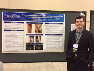 Dmitriy Migdalovich, MD at a poster session