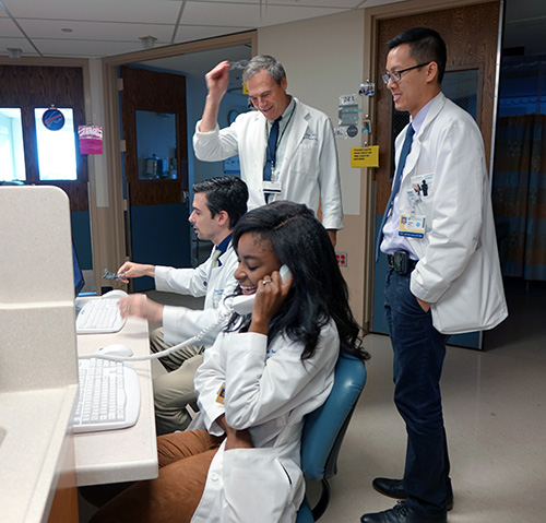 Fellows rounding under the supervision of Department of Medicine Chair, Paul Levy, MD