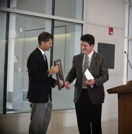 Byron Kennedy (Associate Director) presenting award to Andrew Doniger (Director of Monroe County Public Health Dept) in Saunders Research Building