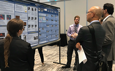 Resident Presenting His Poster