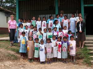 Honduran school children in pillowcase dresses donated by Angels of Mercy in Rochester, NY