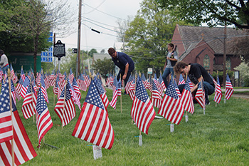 Volunteers placed over 300 flags in precise lines on the front lawn at Jones Memorial Hospital during the 2015 Field of Flags.
