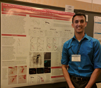 Photo of Keshov Sharma in front of a scientific poster at a conference in San Diego
