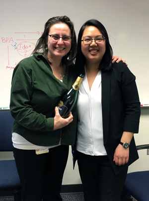 Photo of Drs. Wong and Majewska with champagne bottle