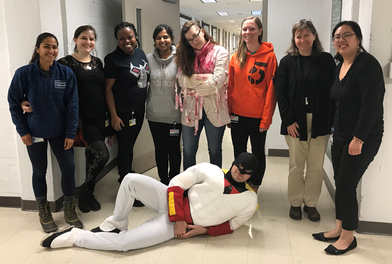 Group photo of Majewska lab personnel in halloween costumes