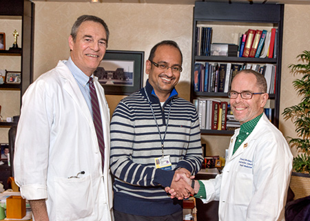 Drs. Levy and Bordley present award to Dr. Tejani