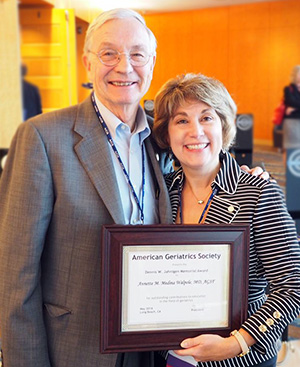 Annette Medina-Walpole, MD (right) wins Dennis W. Jahnigen Memorial Education Award.  Bill Hall, MD (left) is previous recipient.