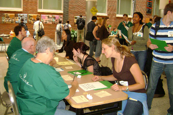 attendees and staff conversing at tables