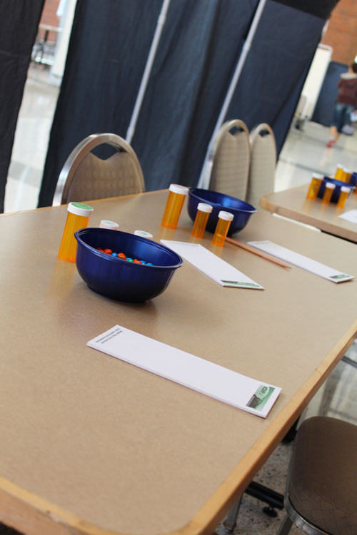 DSH 2015 - tables with pill bottles, bowls and pads