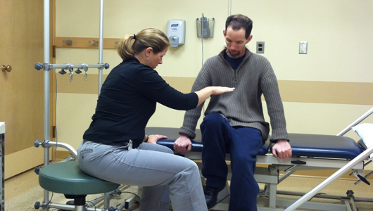 nurse doing PT with patient