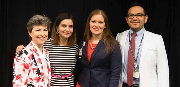 image of Dr. Patricia Chess, Vice Chair of Education, and Pediatric Fellows at Grand Rounds