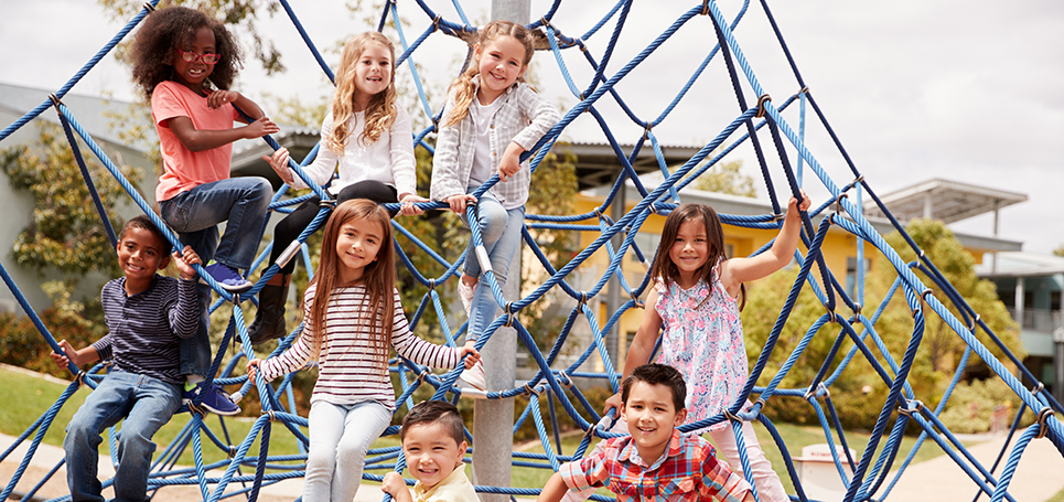 Group of kids climbing at the playground