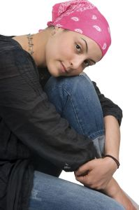 female cancer patient wearing pink head scarf