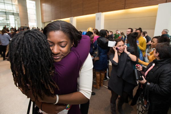 Tamara John [R] who will be heading to Yale for orthopedic surgery, receives a hug from classmate Millicent Okereke