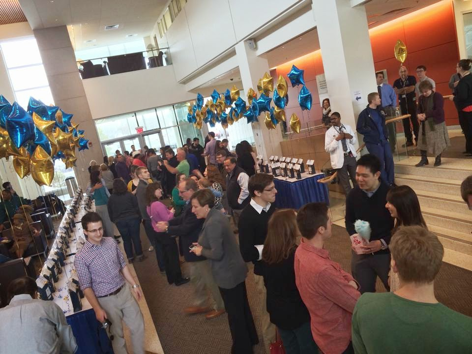 long shot of crowd of students and relatives in saunders research building atrium