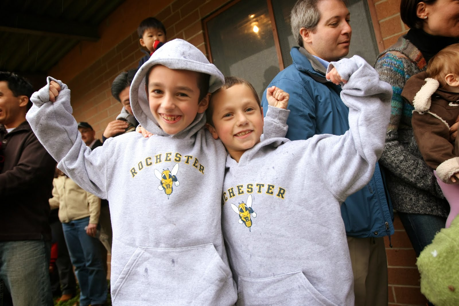 boys in University of Rochester clothing