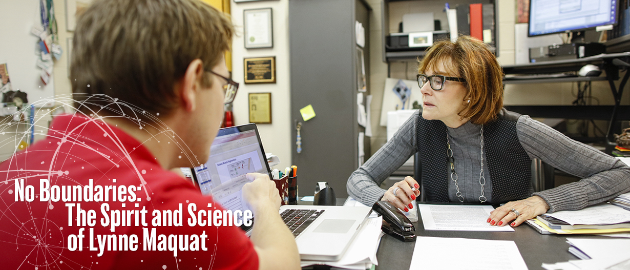 Lynne Maquat with a student in the lab