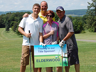 First place team holding sign: Thanks to our Title Sponsor - Elderwood