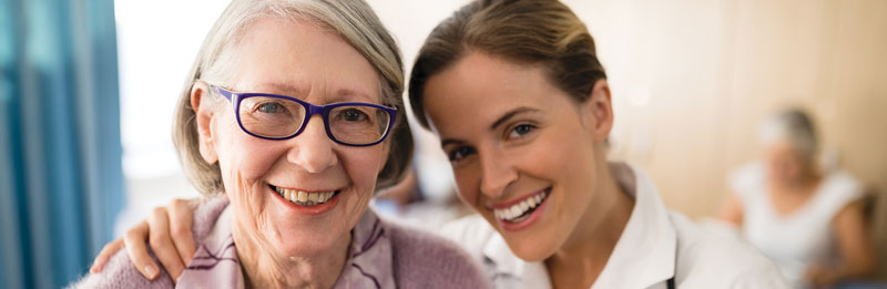 Healthcare provider smiling with elderly patient