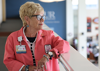Rose looks out over the Strong Memorial Hospital Main Lobby Atrium during our interview.