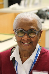 Betty McClenney volunteers at the family waiting room reception desk.