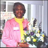 Volunteer delivering flowers
