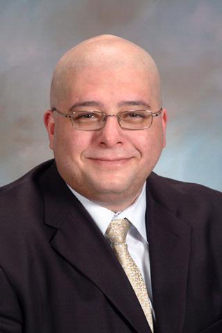 John C. Elfar, M.D.