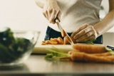Picture of person chopping vegetables.
