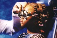 Picture of a young girl wearing trial eyeglasses to determine her prescription