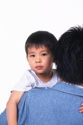 Preschooler looking ofer dad's shoulder
