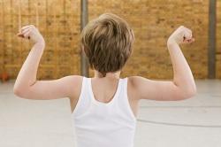 Boy flexing biceps