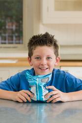 Boy holding bag of chips