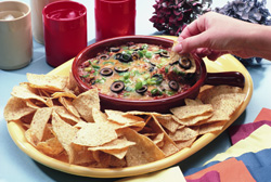 Bean dip on a plate with chips