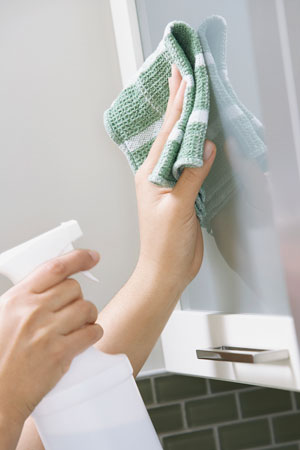 Cleaning with a towel and spray bottle