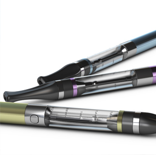 Close up image of three vape/e-cigarettes on a white background.